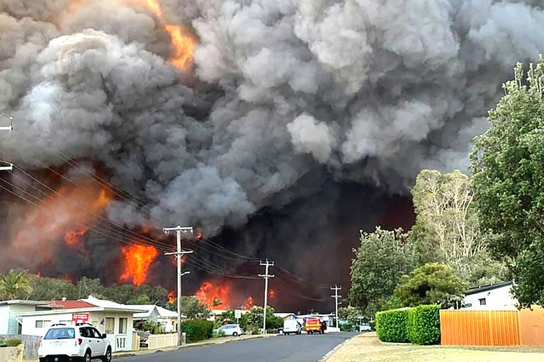 At least two people have died and 100 homes have been destroyed as an unprecedented number of bushfires tore through eastern Australia Saturday.  New South Wales premier Gladys Berejiklian also said seven people were unaccounted for, as firefighters tried to contain dozens of out-of-control blazes that have raged in the state since Friday.  'At this stage, it appears at least 100 homes have been destroyed in yesterday's bush fires,' the fire service said in an update early Saturday.