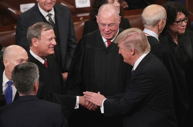 During his Senate confirmation hearing to become chief justice of the US Supreme Court, John Roberts compared the position to that of an 'umpire' above the political fray.  Nearly 15 years later, Roberts is headed back to the Senate, plunged into one of the bitterest political battles in US history -- the impeachment trial of President Donald Trump.  As chief justice of the nation's top court, the 64-year-old Roberts will preside over the proceedings to determine whether Trump should be removed from office for abuse of power and obstruction of Congress.