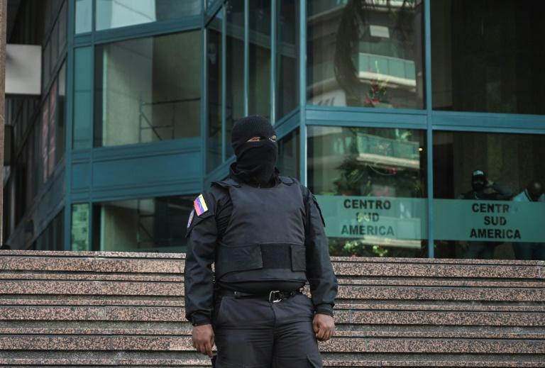 Agents from Venezuela's Sebin intelligence service on Tuesday raided the offices of opposition leader Juan Guaido while he traveled in Europe, an opposition lawmaker said.  'We have just confirmed that Sebin officers are inside the office of president Guaido,' lawmaker Delsa Solorzano told reporters after speaking with security guards at Caracas's Zurich Tower.