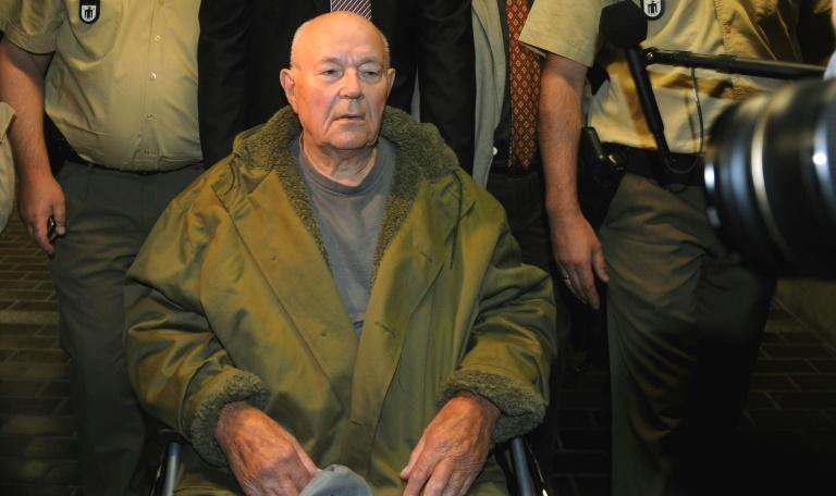 New photos have emerged which for the first time show convicted Nazi guard John Demjanjuk at the Sobibor death camp, a Berlin archive confirmed Monday, although he always denied ever being there.  Ukrainian-American Demjanjuk was convicted of being an accessory to the murder of nearly 30,000 Jews at Sobibor by a German court in 2011.  According to the Berlin-based Topography of Terror archive, photos of Demjanjuk are among a newly discovered collection of more than 350 snaps which give 'detailed insight' into the camp in German-occupied Poland.