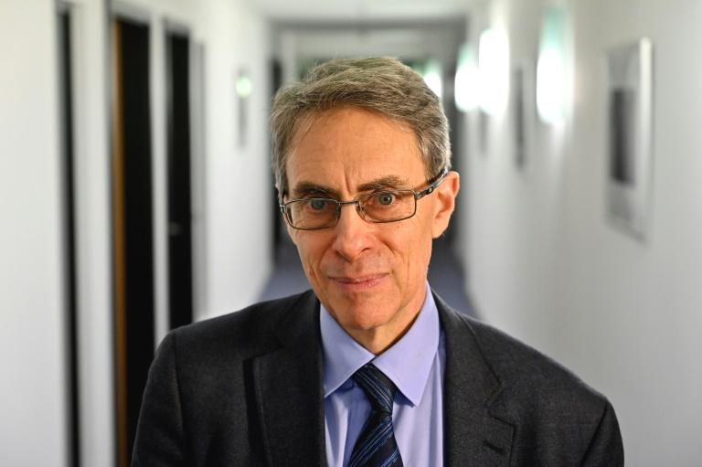 China on Monday defended barring the head of Human Rights Watch from entering Hong Kong, saying non-governmental organisations were responsible for political unrest in the city and should 'pay the proper price'.  Kenneth Roth was supposed to give a press conference in Hong Kong this week to unveil the New York-based rights group's latest global survey, which accuses China of prosecuting 'an intensive attack' on international human rights agencies.