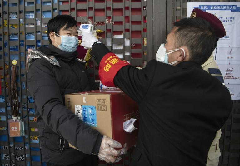 The number of deaths and new cases from China's coronavirus outbreak spiked dramatically on Thursday after authorities changed the way they count infections in a move that will likely fuel speculation that the severity of the outbreak has been under-reported.  The hard-hit central province of Hubei reported 242 deaths in just one day and 14,840 new patients -- by far its biggest one-day tally since the crisis erupted last month.  The jump raised the death toll to 1,355 and the total number of nationwide infections to nearly 60,000 -- just hours after President Xi Jinping touted 'positive results' from the government's drastic measures to contain the virus and a top Chinese expert predicted the epidemic would peak this month.